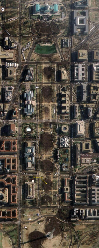 This image provided by GeoEye Satellite Image shows Washington D.C.'s National Mall and the United States Capitol (top), in Washington D.C. on Tuesday, Jan. 20, 2009 taken at 11:19AM EDT during the inauguration of President Barack Obama. The image, taken through high, wispy white clouds, shows the masses of people between the Capitol and the Washington Monument. (AP Photo/GeoEye Satellite Image)