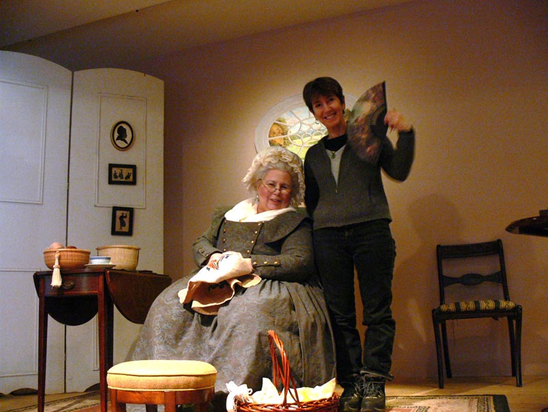 Annie gets needlepoint lessons from Lady Martha Washington, Oscar-worthy reenactor.